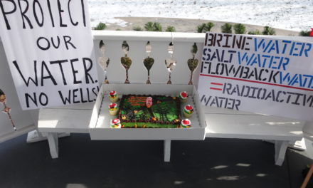 Prayer vigil connects earthquake to injection well protest