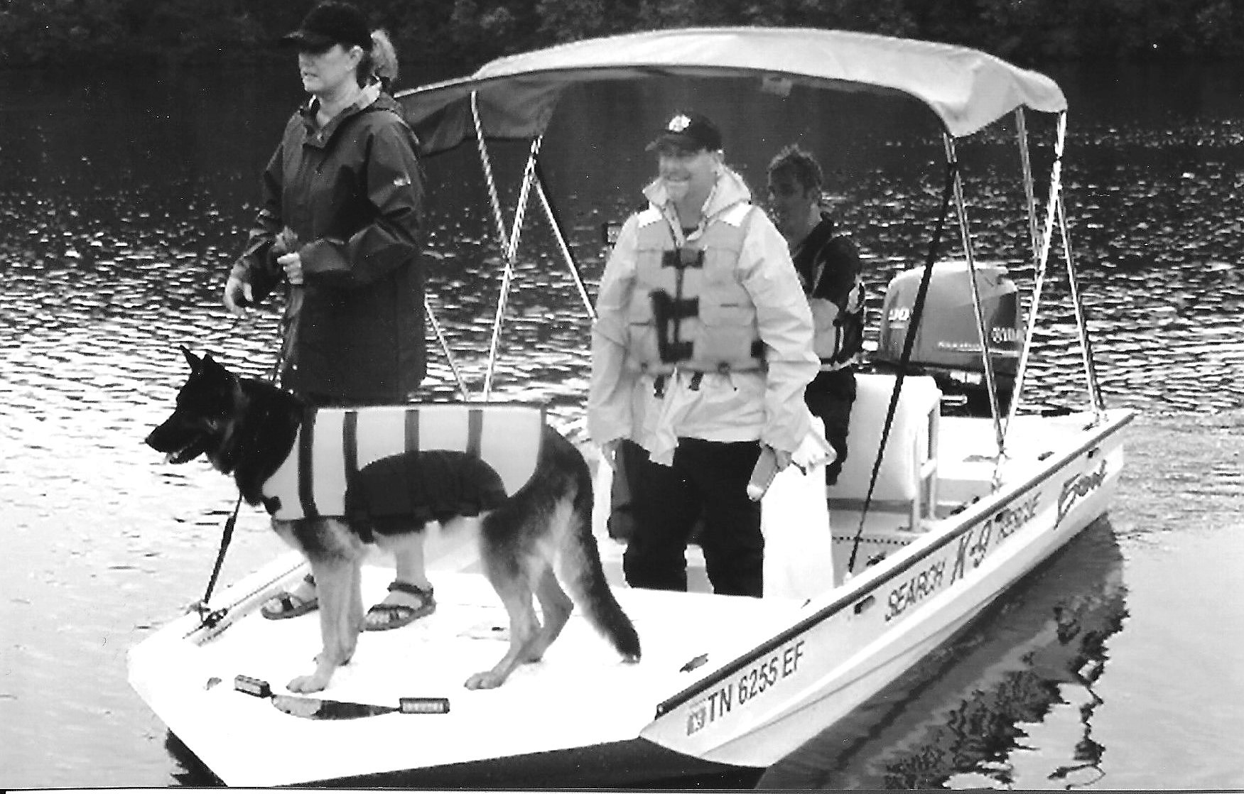Dan Berecek, in light colored vest, with Josey, his search-and-rescue dog.