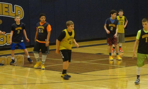 Ball team exceeds goal, pays it forward