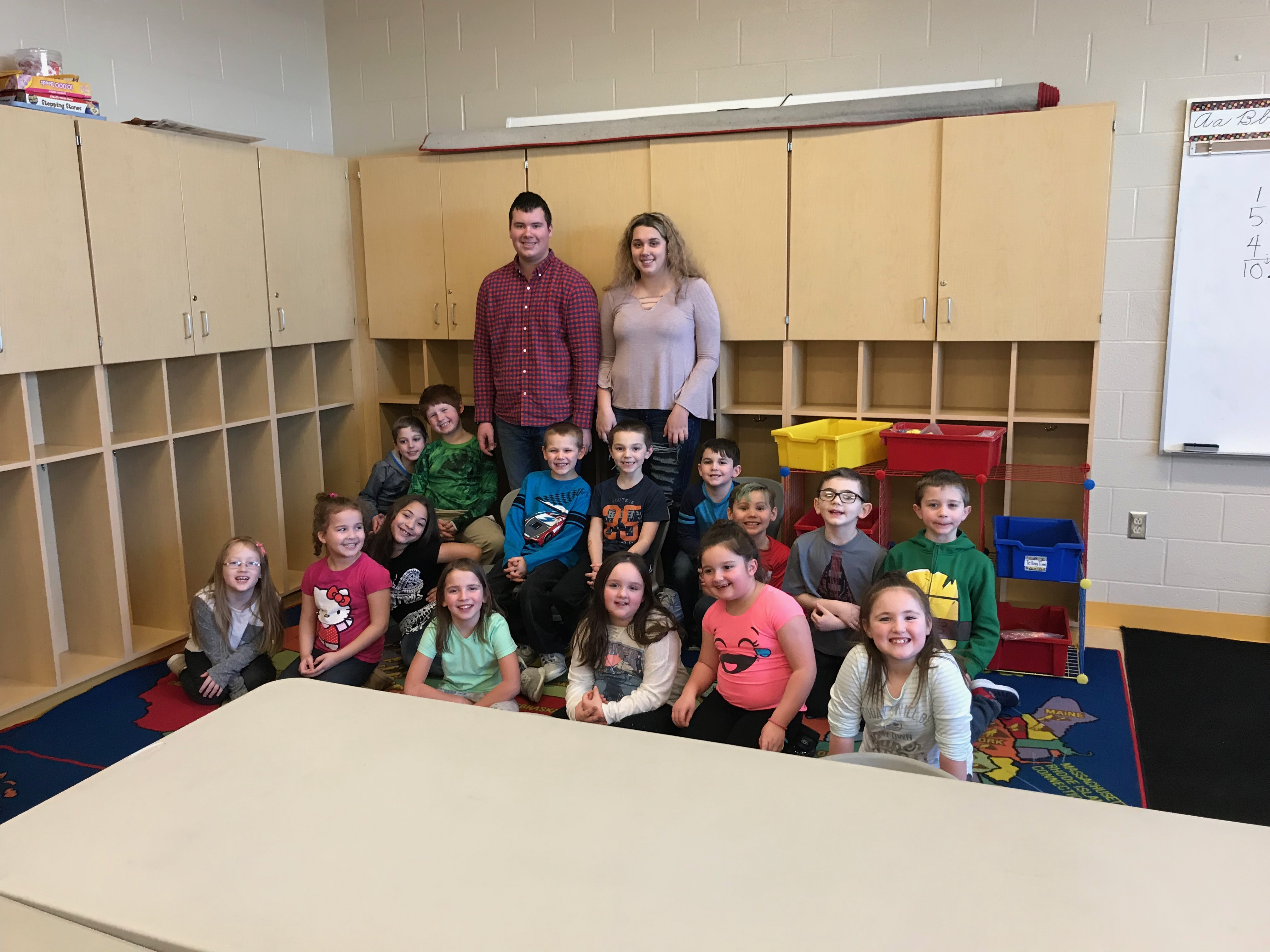 Dakota and Emily Obermiyer stand with the Brookfield Elementary students who participated in a reading study. Students are, front row, from left: Kayla Kikel, Ashten Keith, Isabella Montalvo, Lillian Trump, Gabriella Poggi, Mianna Cinicola and Teeaghan Kane. Back row: Greyson Berena, Daniel Bartha, Mason Davis, Blake Lough, Lane Pegg, Logan Huffman, Damien Raver and Shane Hoffman. The photo was provided by the school.