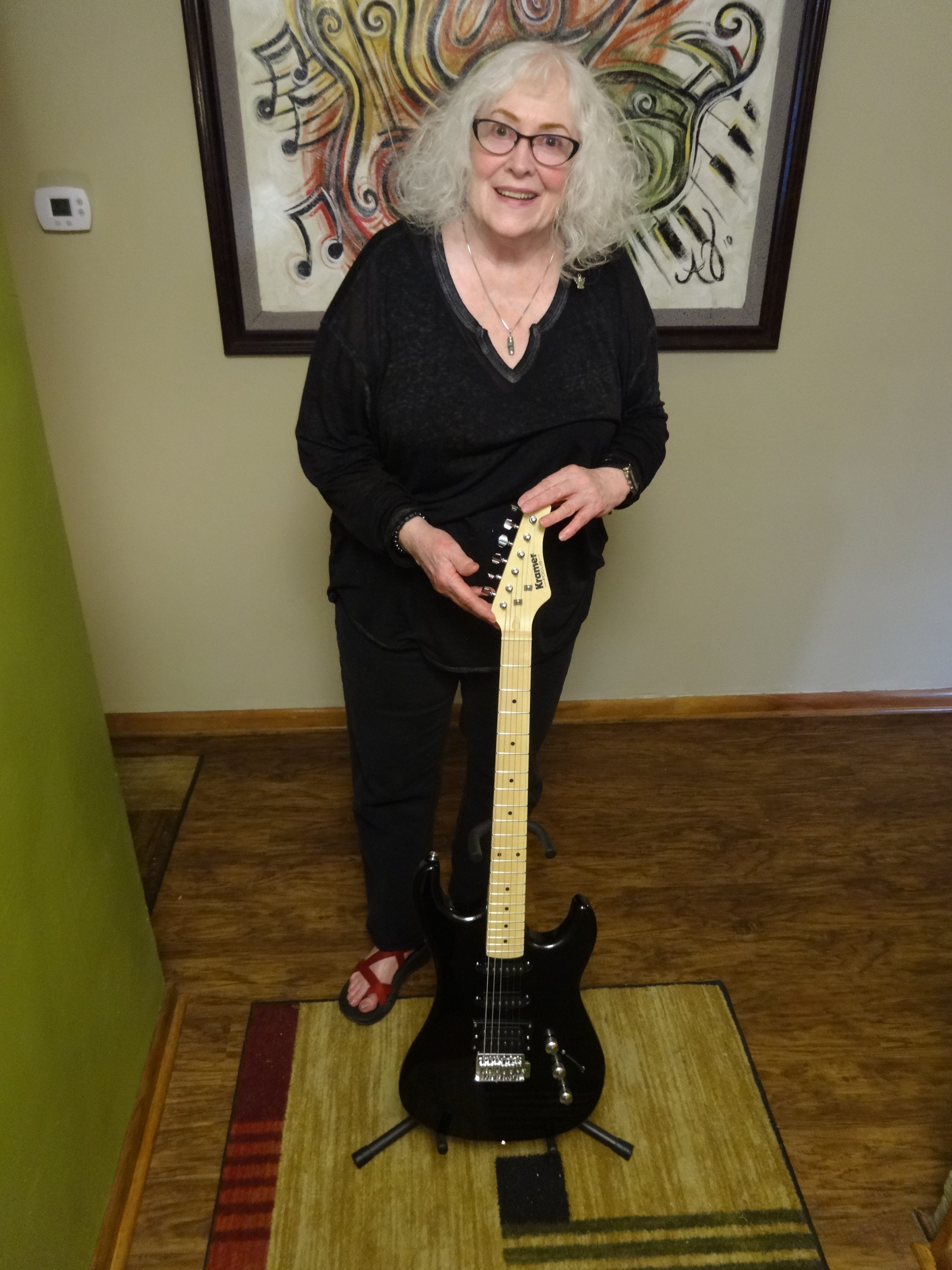 Carol Wiercinski shows one of the guitars that will be auctioned off at Treystock, the annual benefit rock concert honoring her son, Trey Filer.