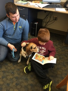Dakota Obermiyer sits with Beezus and a Brookfield Elementary student who participated in a reading study. Photo provided by the school.