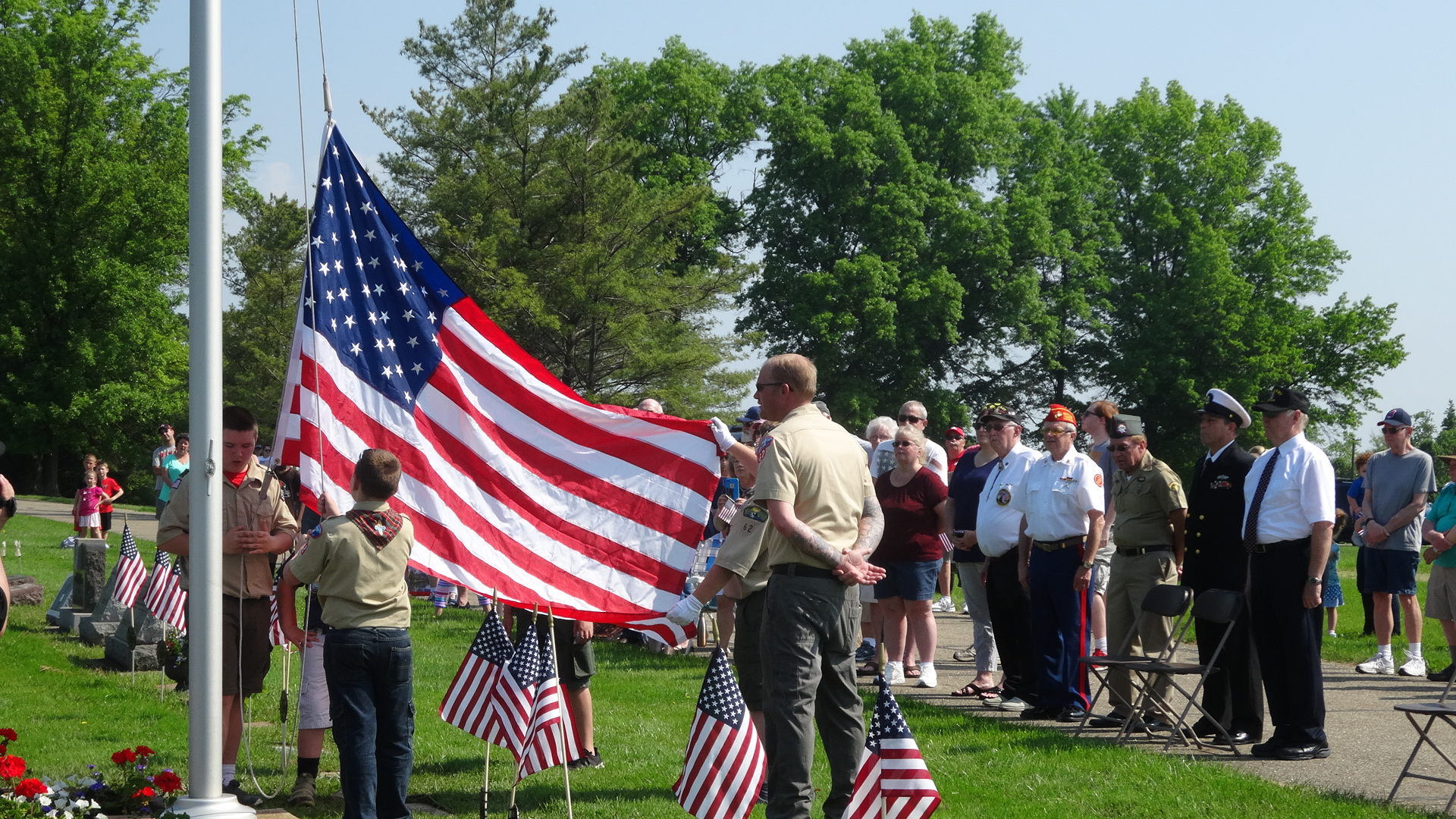 Cub Scout Pack 62 raises the flag at Brookfield's Memorial Day ceremony.