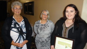 Noelle Swartz, right, is shown with Brookfield-Masury Women's Club member Mary Schmidt, left, and club President Ruth Hawkins.
