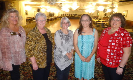 Women's Club installs officers