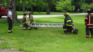 Cadets at the Howland Township Fire and EMS Training Center's eight-week Firefighter II training course at Brookfield Fire Department work on their teamwork and ladder handling skills.