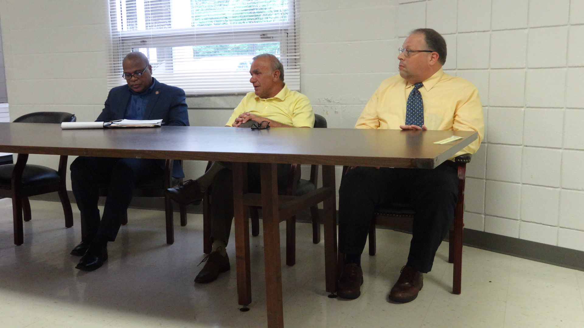 Trumbull County Commissioner Frank Fuda, center, speaks a meeting about the injection wells proposed for Brookfield. Also shown are state Sen. Glenn Holmes, left, and Trumbull County Health Commissioner Frank Migliozzi.