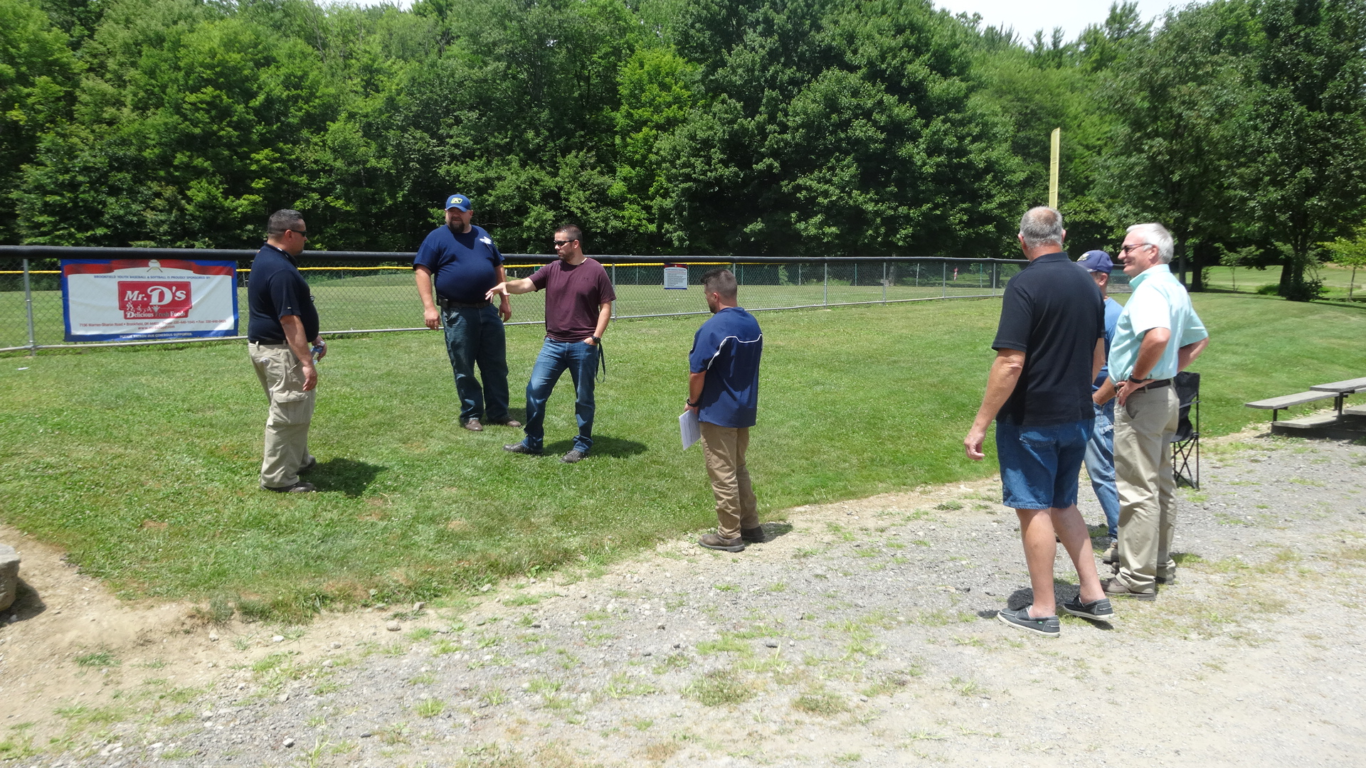 Brookfield Township officials, right, watch as representatives of Ohio Edison and Becdel Controls discuss plans to upgrade the electrical service at Brookfield Township Community Park.