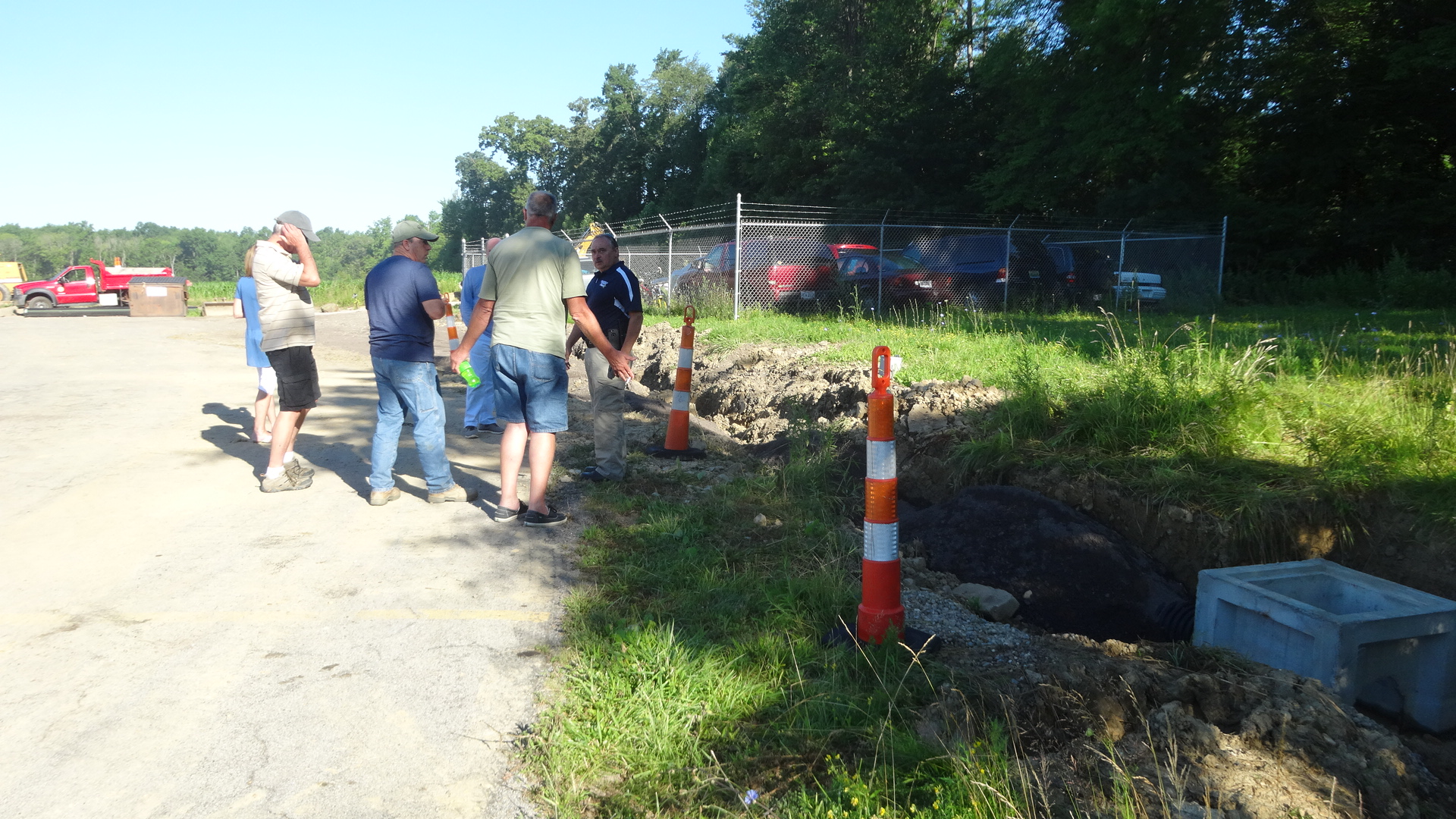Police Chief Dan Faustino, right, shows trustees and others the work the road department had to do to prepare for an expansion of the impound lot.