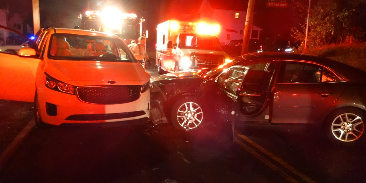 Woman taken to hospital in 2-car crash