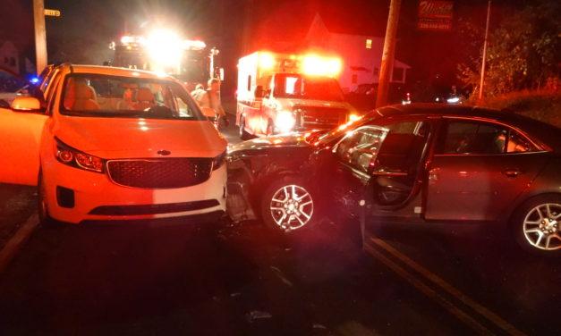 Woman taken to hospital in 2-car crash