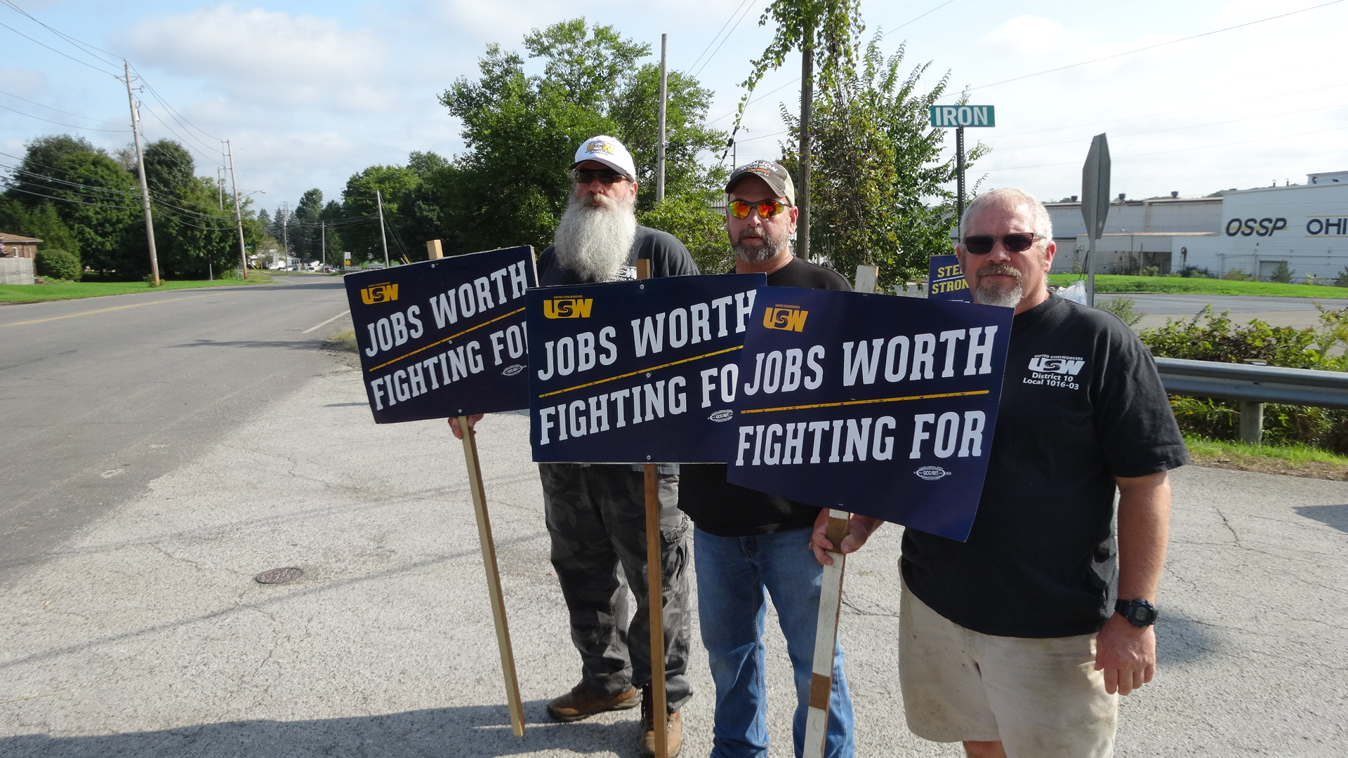 Roemer Industries unionized employee Kurt Wedge, center, is joined by Jesse Bassett, left, and Robert Hendrickson, fellow United Steelworkers from NLMK in Farrell.