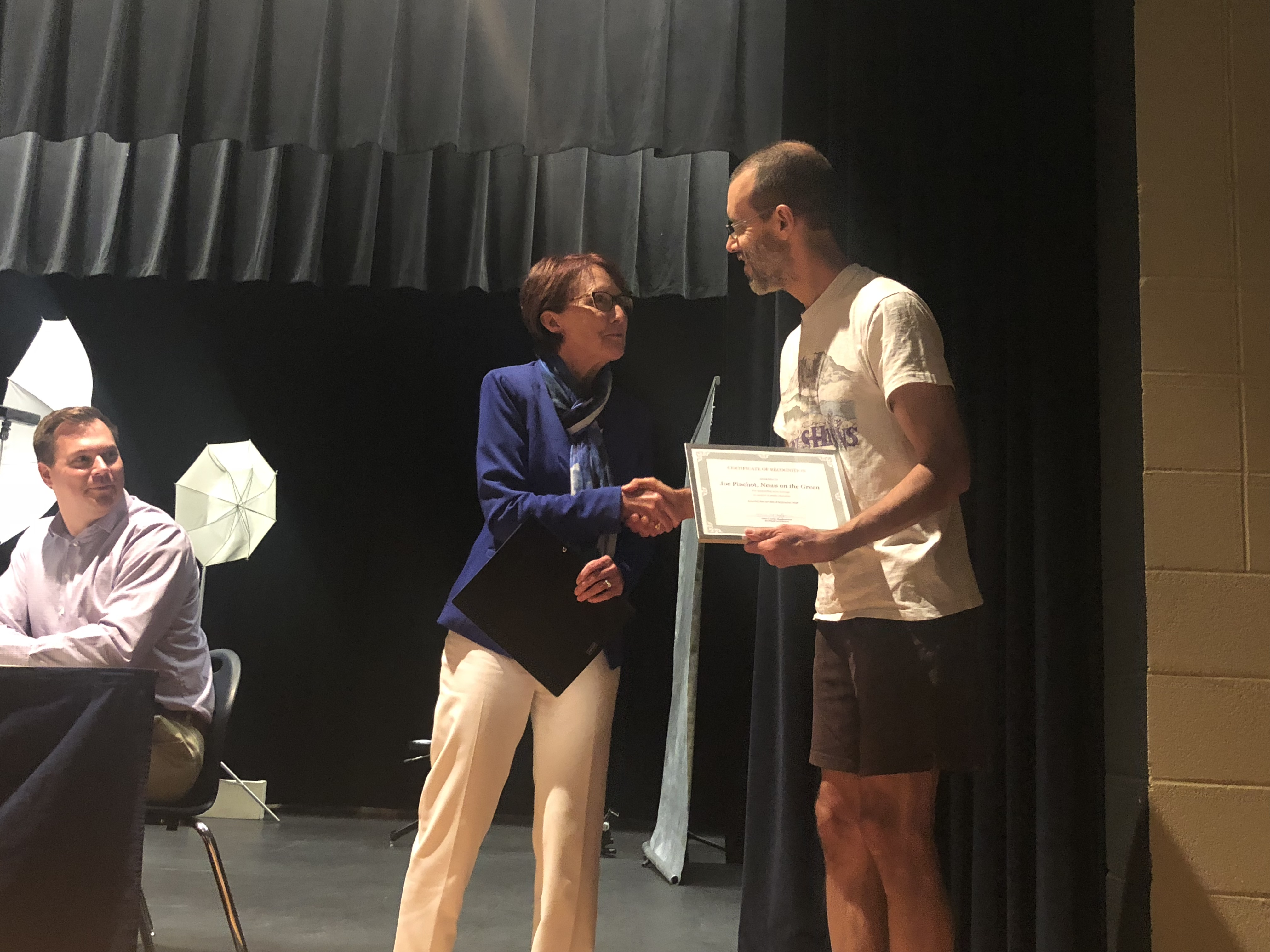 Joe Pinchot receives the Ohio School Boards Association 2018 Media Honor Roll award from Brookfield Local School District Superintendent Velina Jo Taylor. District Treasurer Craig Yaniglos is at left.