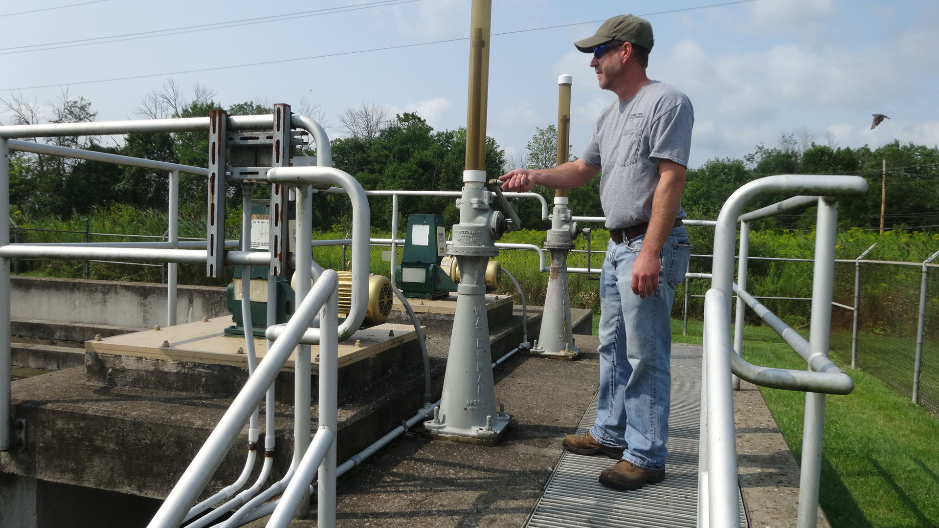 Dave Armstrong, chief operator of the Brookfield Wastewater Treatment Plant, is shown at the chlorine contact tank, one of the processes that will be removed in a plant renovation.