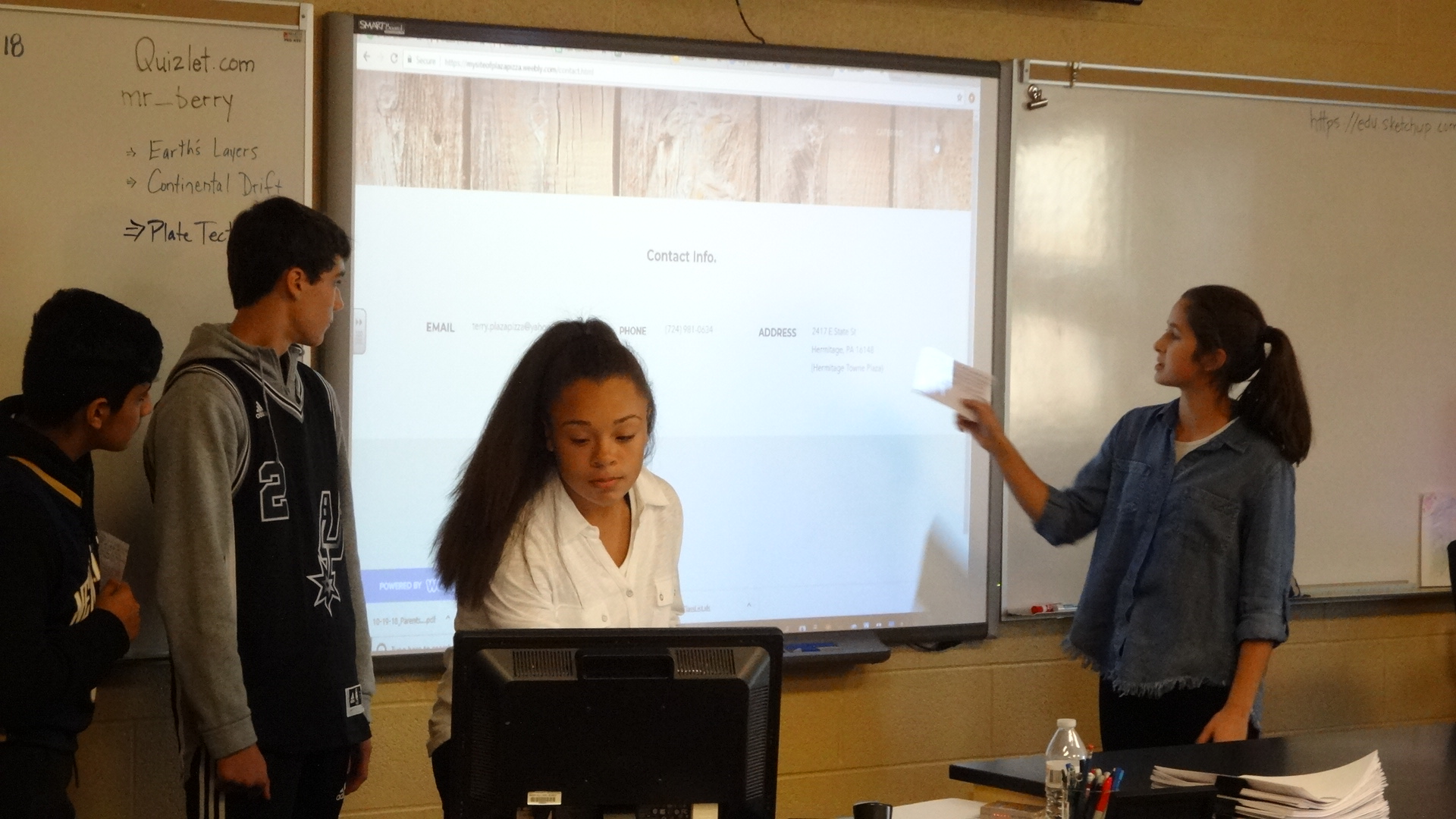 Sophia Hook, right, explains a web site her team created for Plaza Pizza. Also shown are, from left, Tariq Omar, Luca Franz and Jenae Pugh.