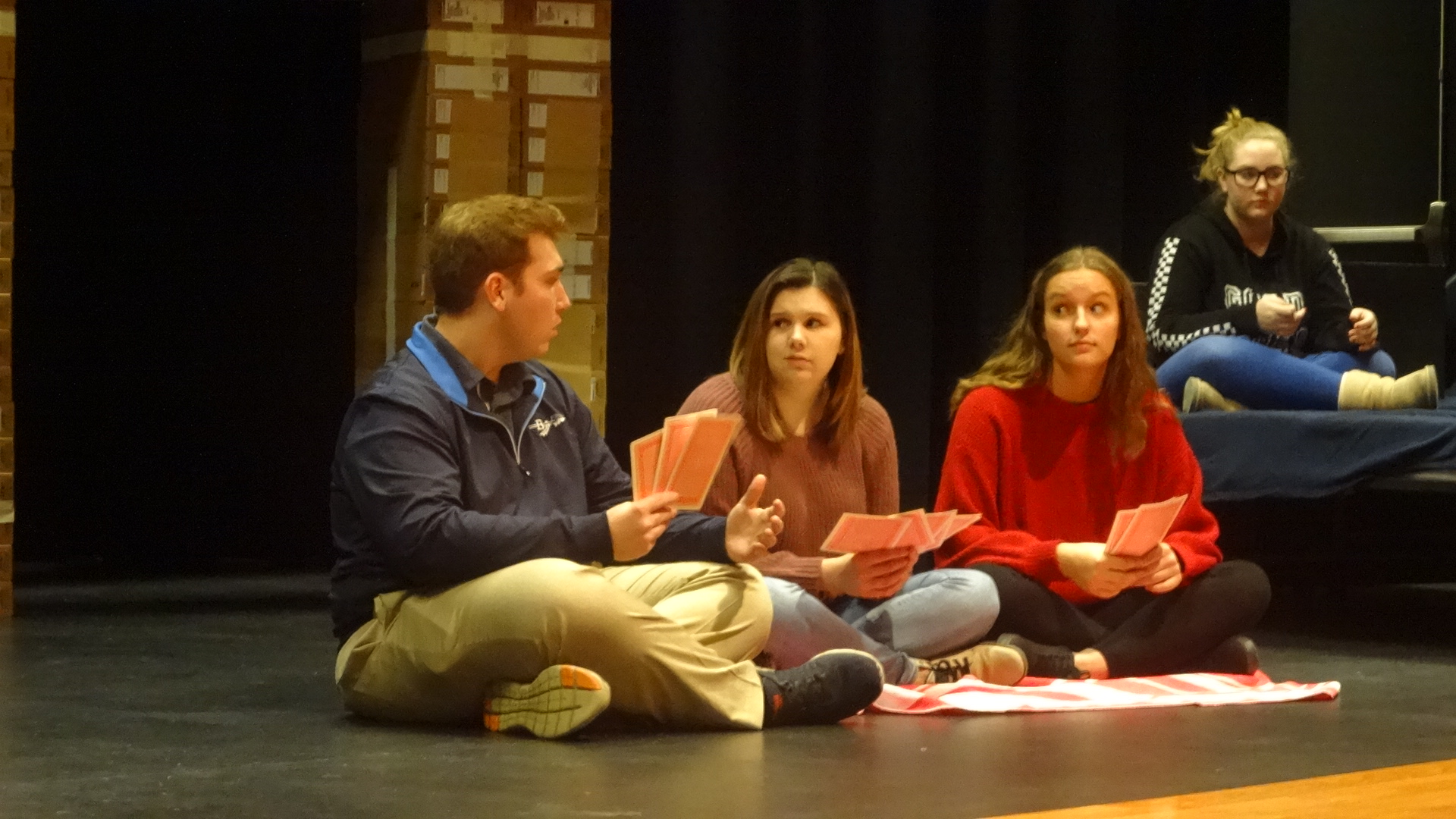 "Shawn Hitt, Tammra Clark, and Brooke Kirila play ""Go Fish"" in ""What Could Go Wrong the Night Before Christmas?"" a short play that Brookfield Drama Club will present Dec. 8 at Christmas in the Country at Brookfield High School. Caitlyn Tribe is at right."