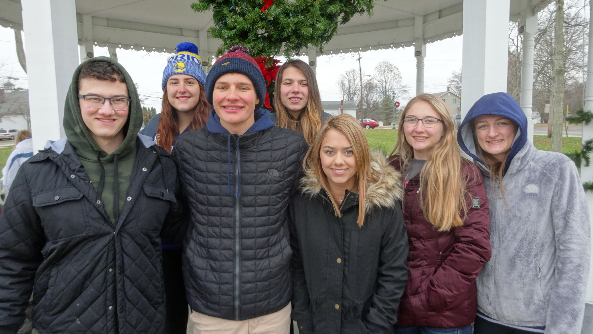 Members of the Brookfield High School Interact Club, shown here, helped members of the Brookfield Township Historical Commission and Brookfield trustees decorate the green in Brookfield Center for the holidays.