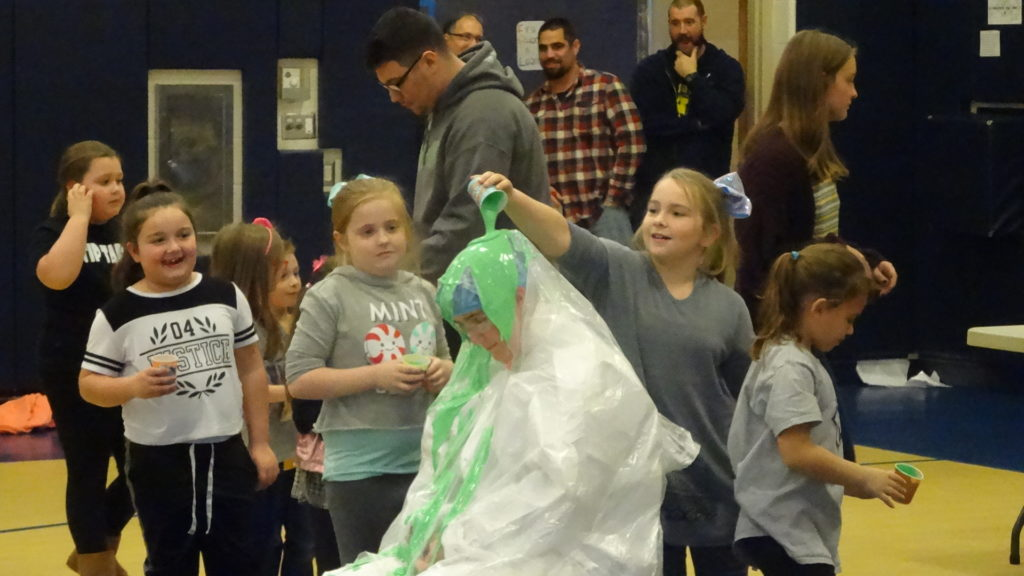 Payton Curry dumps slime on Principal Stacey Filicky.