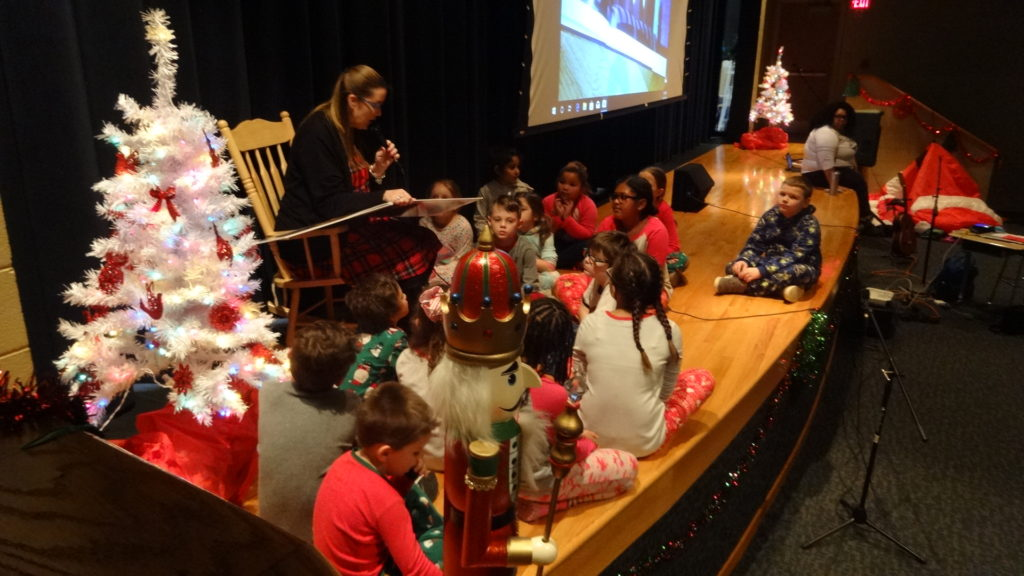 "Brookfield Elementary School Principal Stacey Filicky reads ""The Polar Express"" by Chris Van Allsburg to her students."