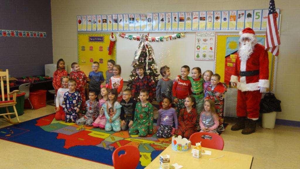 Santa Claus photobombs Jessica Zebroski's class photo.