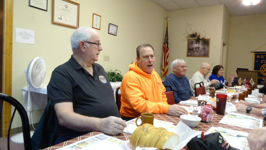 George Vranich, left, listens to Jaime Fredenburg at the Brookfield Rotary Club veterans appreciation luncheon. Also shown are, from right, club member Jean Wlodarski, Bill Litman and Don Rust.