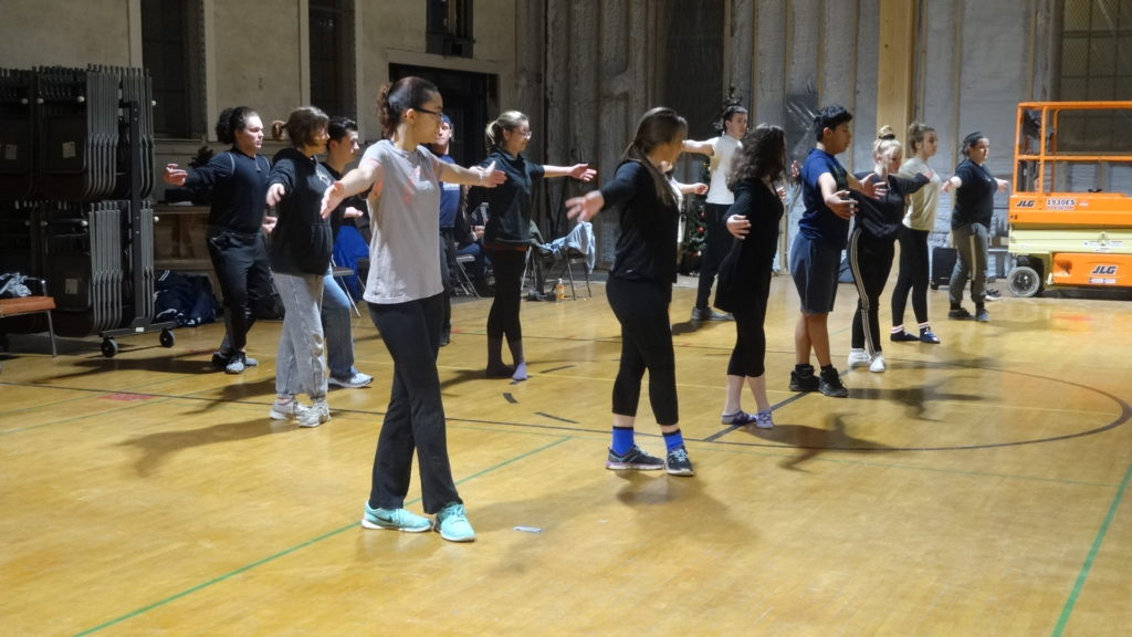 "McCleese Graybill of Brookfield, in foreground, and the rest of the Chrysalis Stage Advanced Performing Arts Conservatory stretch at a recent rehearsal for ""West Side Story."""