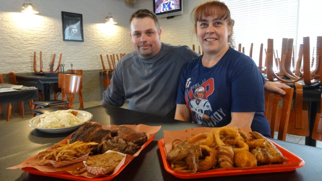 Scott Duncan and Tonia Gray with, from left, country-friend chicken with country gravy, three-meat platter with fries and beans on the side, and an appetizer sampler.