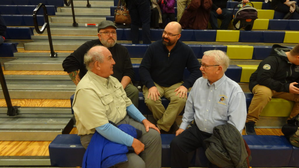 Former Brookfield High School wrestlers Jason Ott, top left, and Eric Ashman, top right, talk with two former coaches, Dave Mischick, bottom left, and Jim Hennessy.