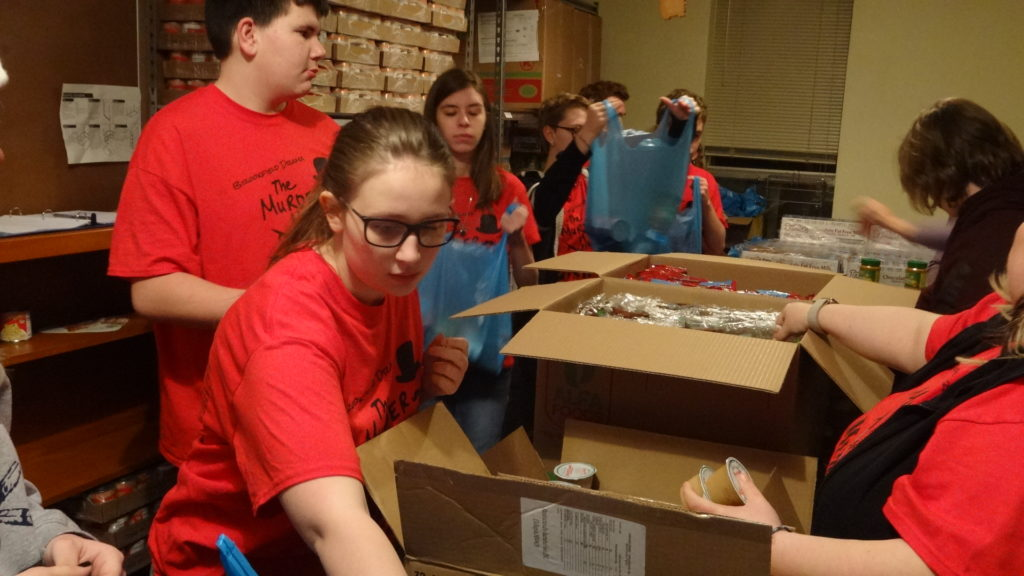 Sarah Hackett, foreground, Gavin Clark and Hannah Montgomery from Brookfield Drama Club load bags for the Brookfield Backpack Program.