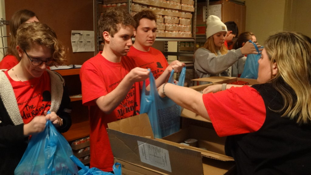 Brookfield High School Drama Club adviser Megan Rodgers places items in a bag for Dane Abraham. Also shown are, from left, Charlee Noel, Shawn Hitt and Brooke Kirila.