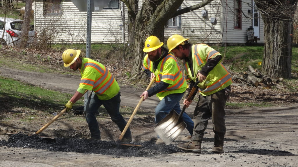 Employees of Wilson Construction Co., New Wilmington, fill holes on North Stateline Road in Masury and Sharon in preparation for paving.