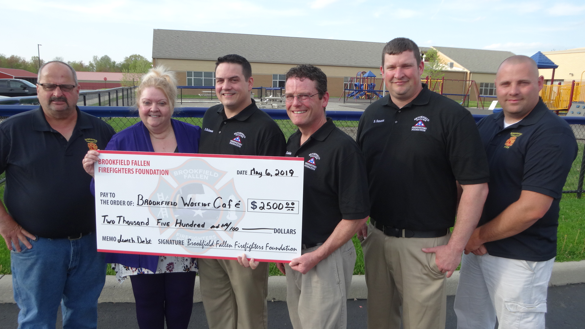 From left, Shenango Township Volunteer Fire Department Engineer Dave Foltz, Brookfield Local School District Cafeteria Director Donna Bailey, Brookfield Fallen Firefighters Foundation representatives Randy Richman, Matt Gordon and Steve Smoot, and Shenango Fire Chief Justin Barnes.