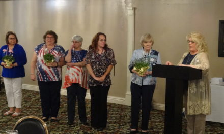 Women's club installs officers