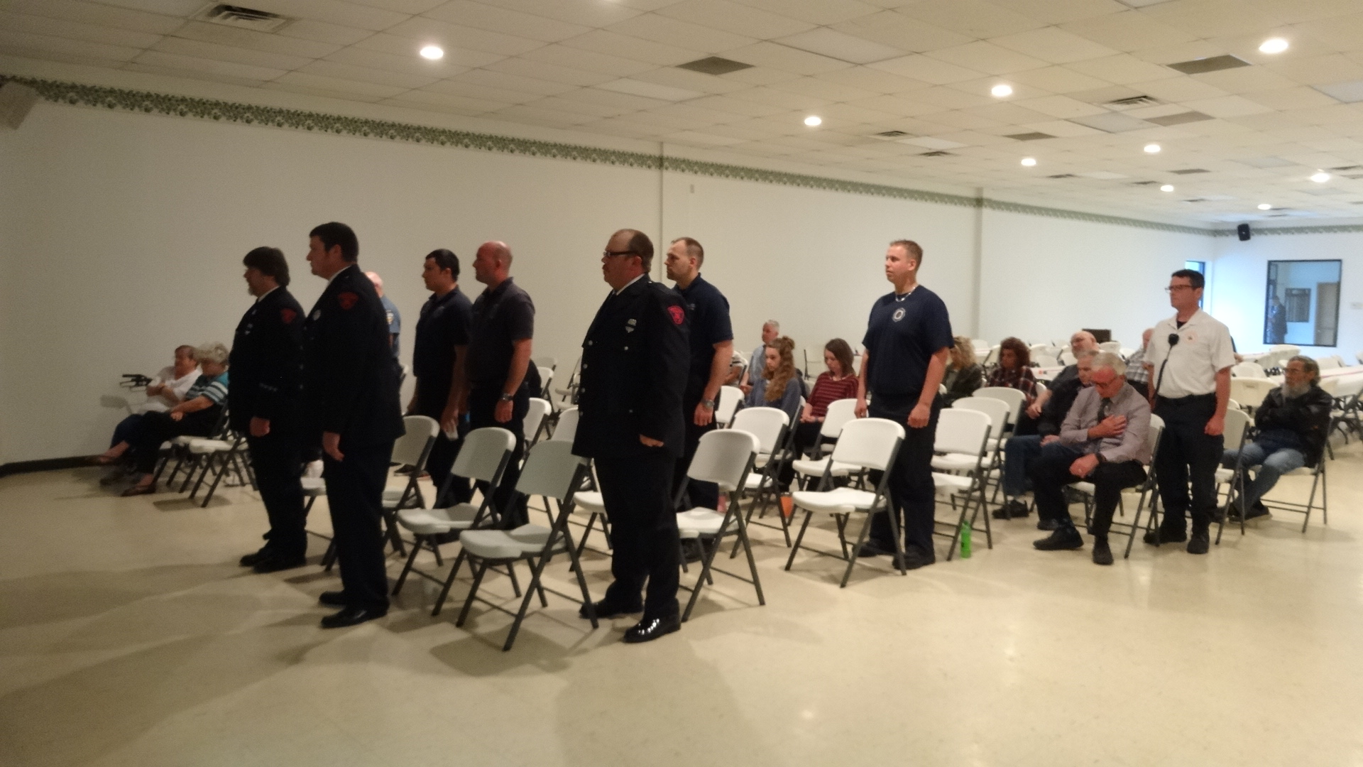 Brookfield firefighters stand for the ringing of the bell to pay homage to firefighters who have died at a memorial service for firefighters, police officers and Brookfield Township Volunteer Fireman's Auxiliary.