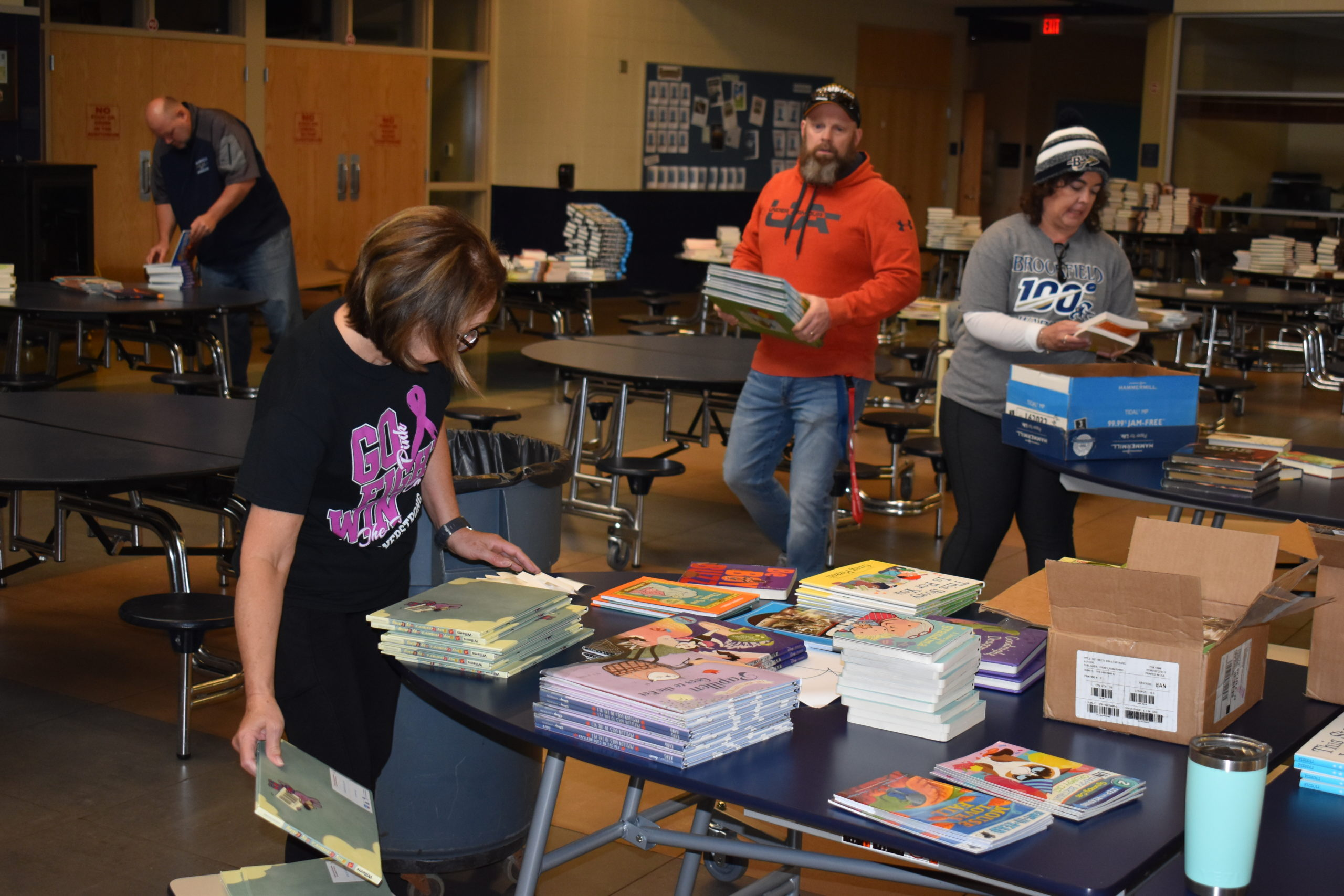 Brookfield teachers, from left, Chris Fahndrich, school nurse Rhonda Zebroski, Jay Bodnar and Mary Arp organize books for an April 30 drive-through book fair at the school. NEWS On the Green photo.