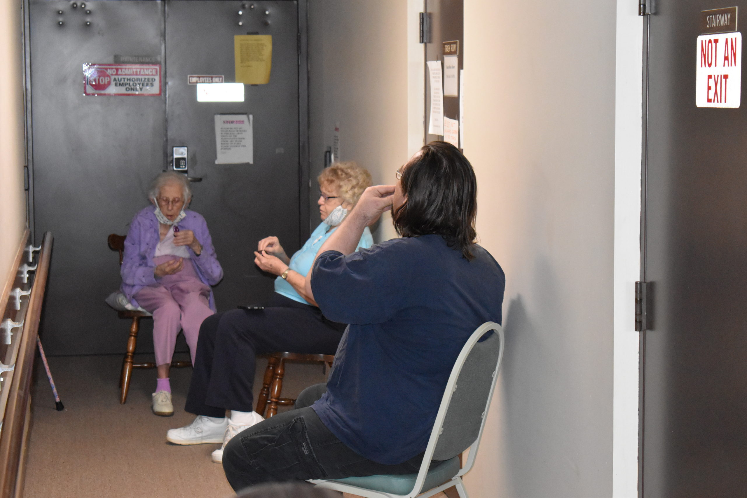 Residents of Valley West apartments, from left, Hazel Howell, Hariett Snyder and Don Armour take communion as they listen to a church service.