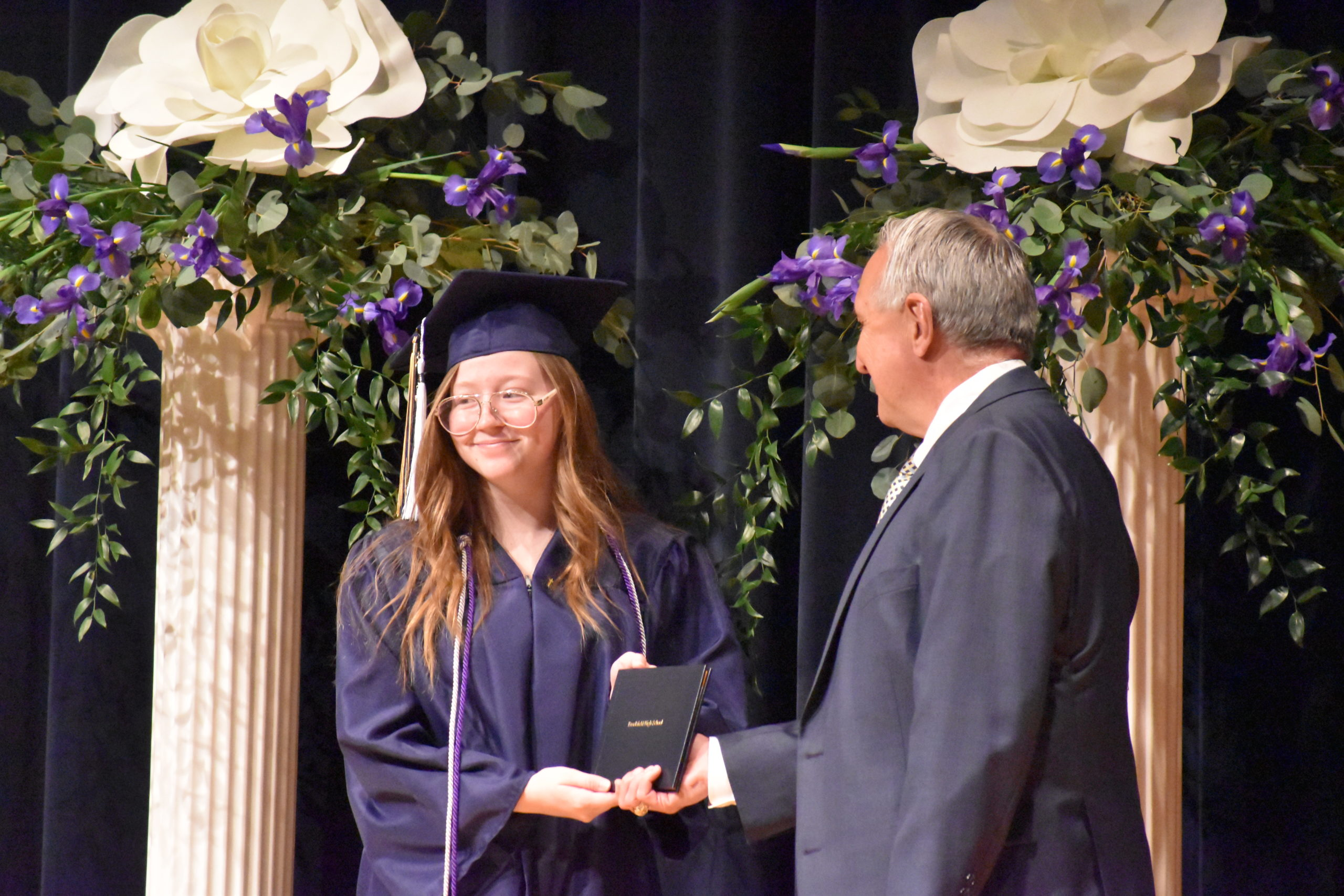 Samantha Craig accepts her diploma from Brookfield Board of Education member Jerry Necastro.