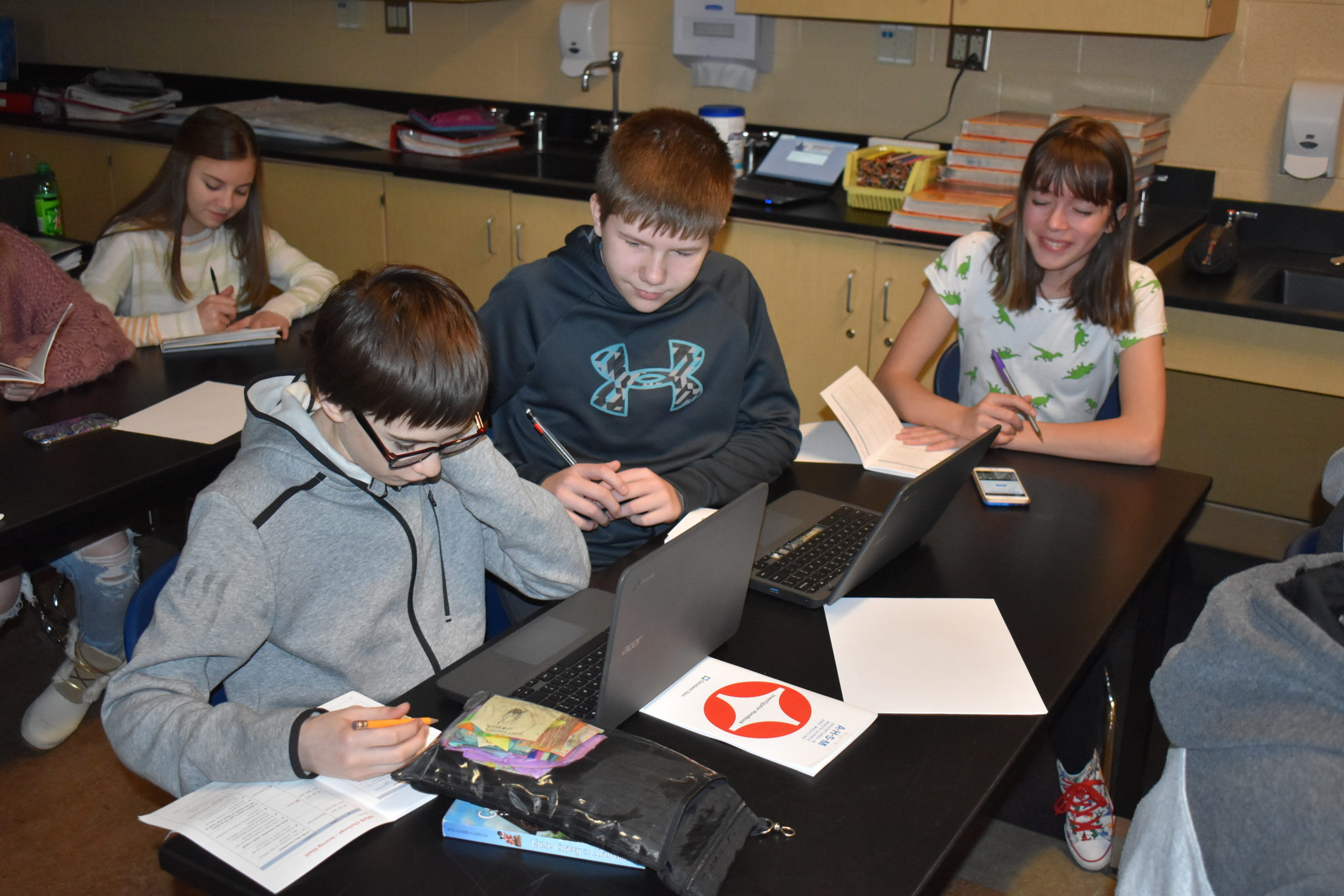 Brookfield Middle School students Robert Brode, front, and Rob Myers use Chromebook computers for a class. Reanna Reardon is pictured at left and Danica Bliss at right.