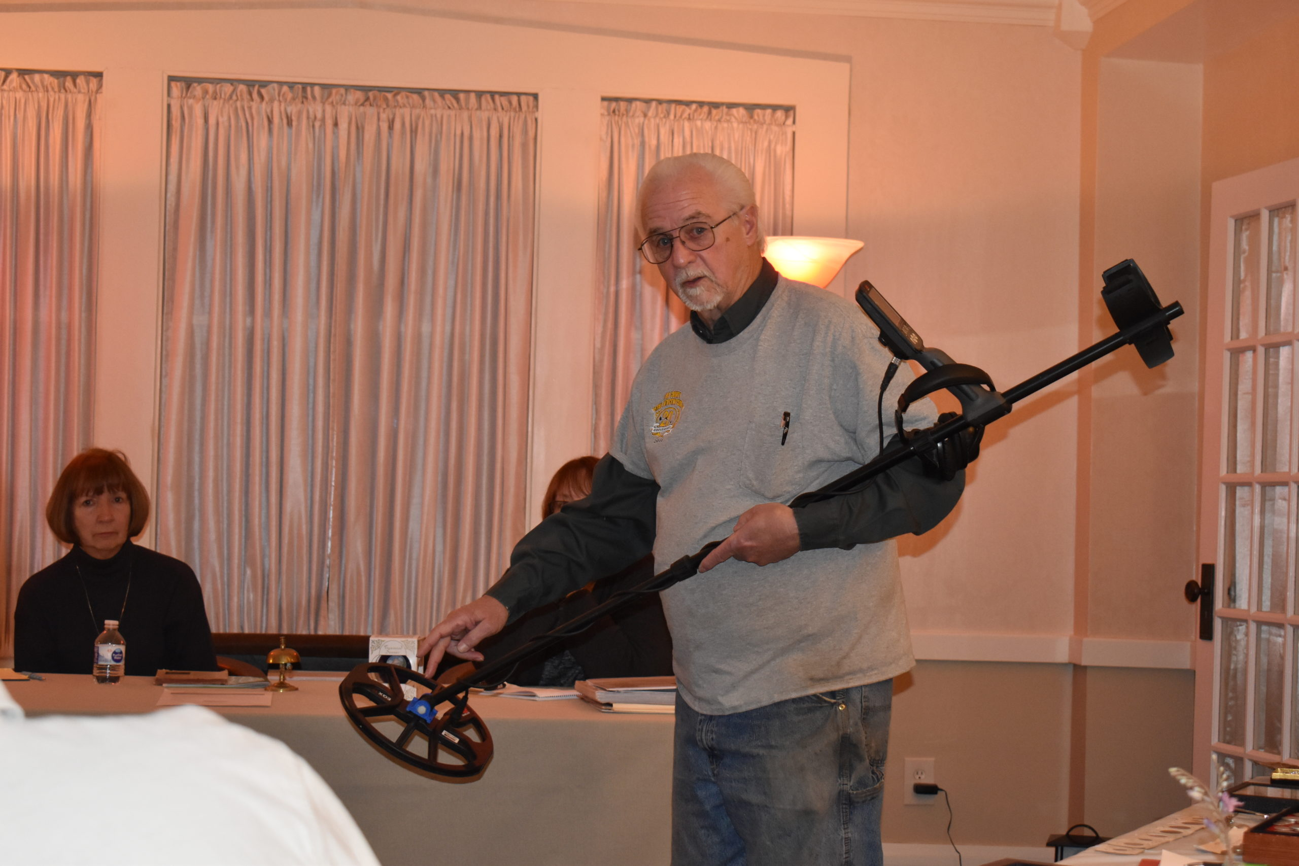 Jesse James shows how a metal detector works at the Feb. 13 meeting of the Brookfield Historical Society.