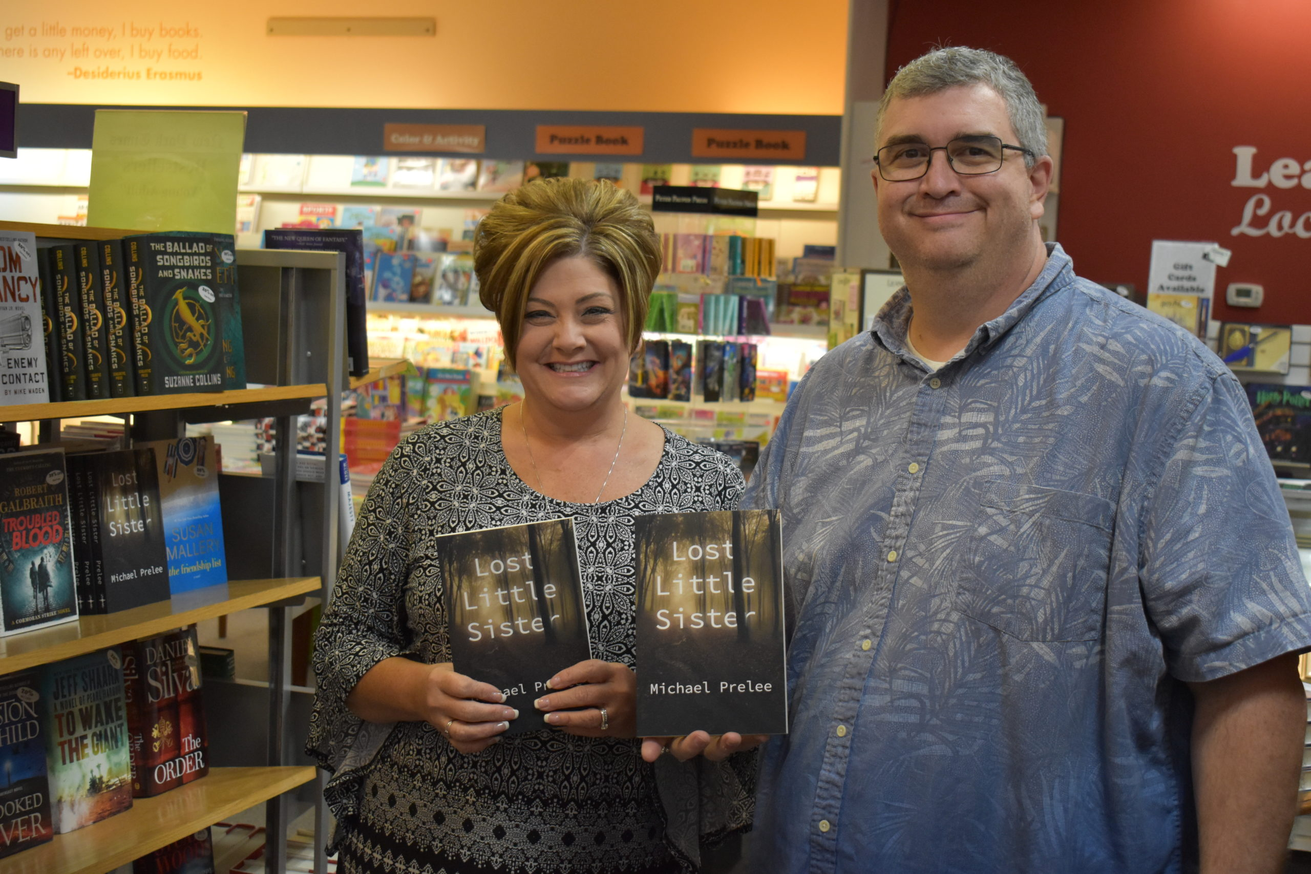 Michael Prelee and Leana Hilliard of Leana's Books, Hermitage, hold copies of Prelee's new novel, which is on sale at Leana's.