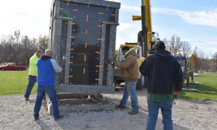 Road crew prepares new cemetery section