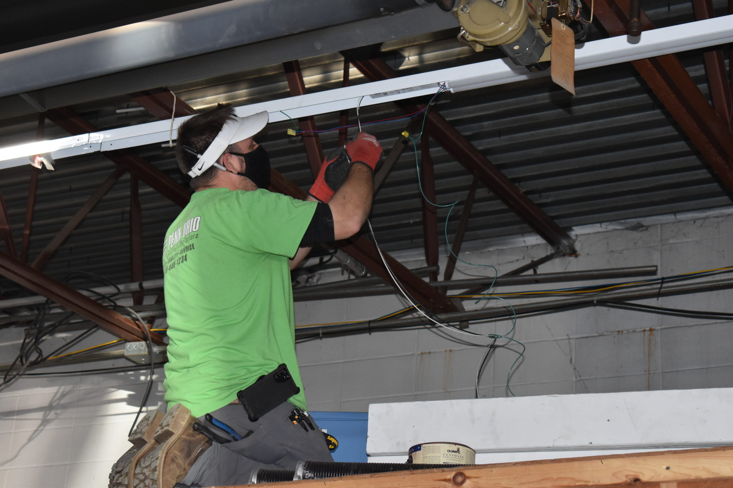 Pete Fedor of Penn-Ohio Electrical Contractors installs new lighting fixtures in the Brookfield Police Department garage.