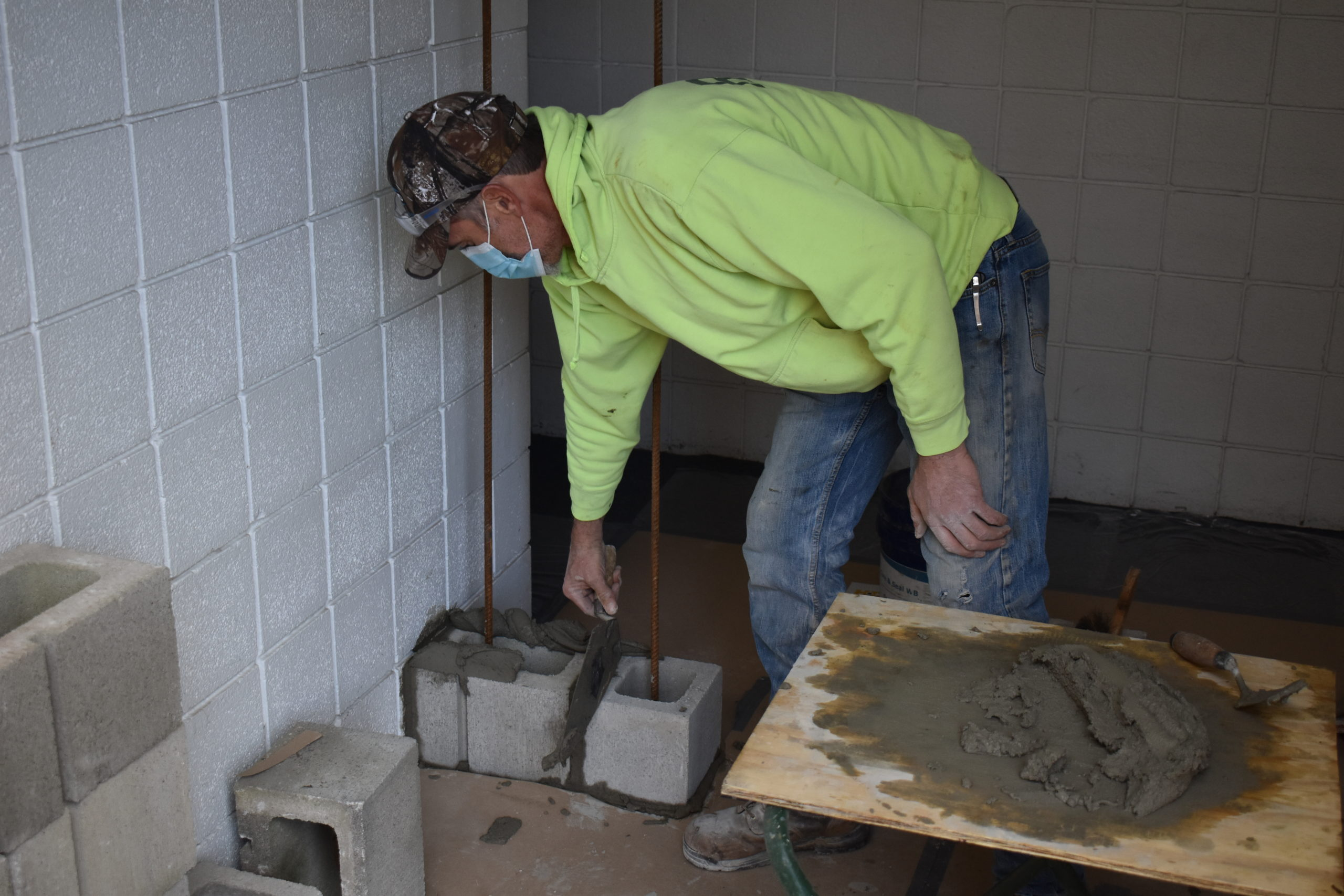 John Hill of Rien Construction blocks in the employee entrance at Brookfield Police Department. The new vestibule will contain a thermometer for logging temperatures of those who enter the building, with the intent to prevent COVID-19 from entering.