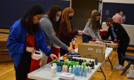 Students stuff stockings for overseas military