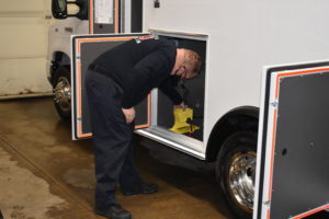 Fire Capt. James Williamson starts sizing up a new ambulance for equipment storage. The ambulance, the department's fourth, was made with CARES Act funds.