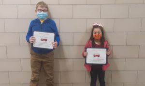 Dilynn Turner and Alivia Sanford hold certificates they received for winning a fire prevention poster contest. Contributed photo.
