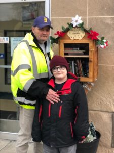 John Wilkes and his son, Jessy, stand with the free library posted at the Masury Post Office in honor of their wife and mother, Rachelle A. Campbell-Wilkes, a postal carrier who died Sept. 6. Contributed photo