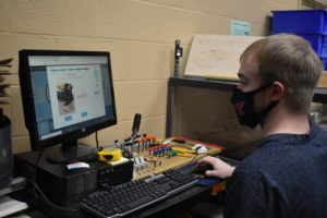 Matt Breighner sets up the computer program for a routing project in the Maker Space at Brookfield Local School District.