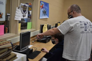 Teacher Jim Haywood and student Austin Sees work on an assignment in the Maker Space.