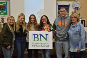 Megan May, fourth from left, and Brookfield Nutrition partner Tony Walls stand with, from left, Carissa Fahndrich, Grace Schultz, Katie Gibson and Debbie Zebroski.